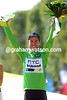 Mark Cavendish is all smiles as he poses with his final Green Jersey of the Tour...