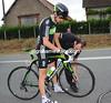Ben Swift gets a swift wheel change at the back of a dawdling peloton...