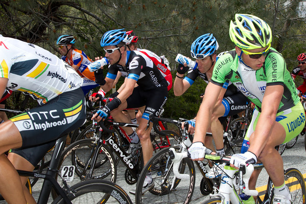 Zabriskie and Vandevelde stay hydrated as they climb Mt. Hamilton.
