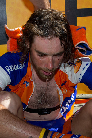 The heat and pace have taken their toll on Ten Dam who left Schleck to solo to third place on the day; he's having soigneurs pour cold water over his head...