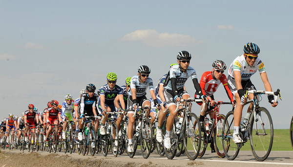 Contador sits at the head of a peloton moving briskly along in pursuit of another escape...