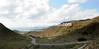 The peloton descends the Puerto del Portman on its way back to the coast...