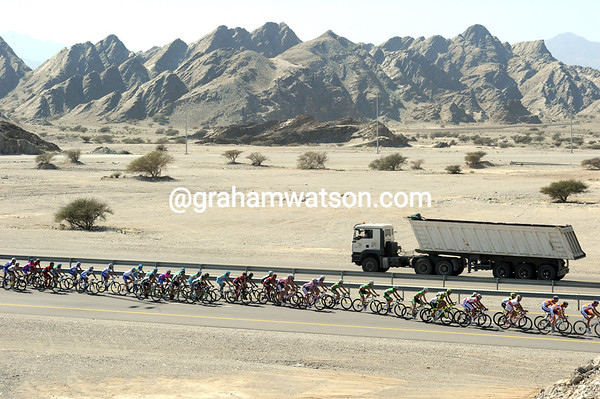 A peloton, a truck, a glorious Omani landscape is created..!