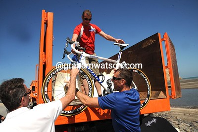 At last - three trucks arrive with the missing bikes, so the stage will only be 45-minutes late starting...