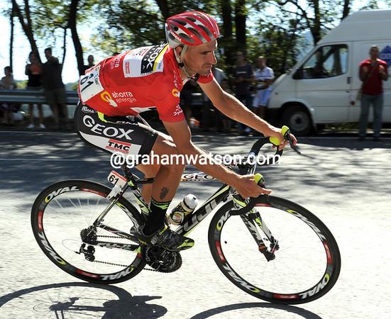 Juan Jose Cobo descends another climb, the Alto el Vivero, awaiting the final battle of the Vuelta...