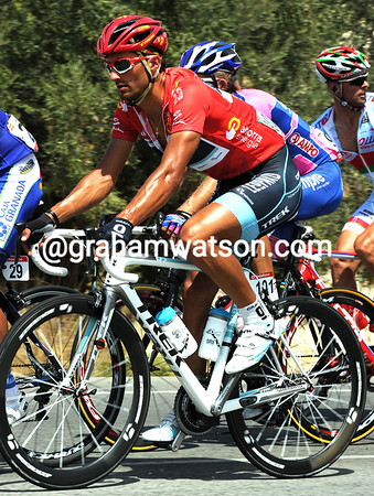 Daniele Bennati looks as hot as his red jersey on a small climb...