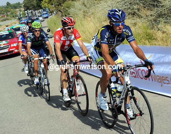 Pydgornyy leads the escape on to the last climb - they still have three minutes with 20-kilometres to go...