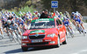 The Vuelta makes a rapid descent behind the pace-car in a neutralized start from Sierra Nevada...