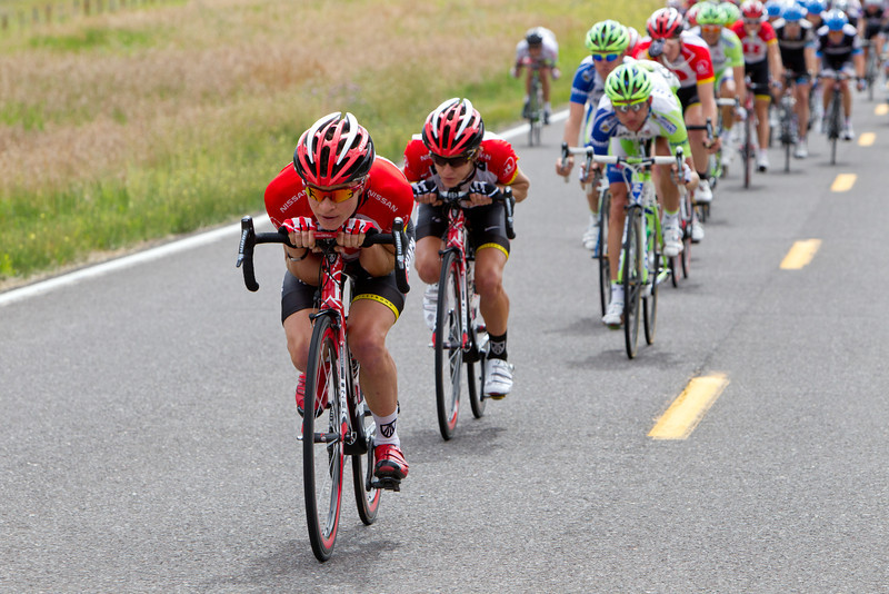 Ben King and George Bennett lead the peloton down the descent before the feed zone.