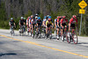 After cresting Rabbit Ears Pass, the lead group is down to 17; who's that shadow tho?