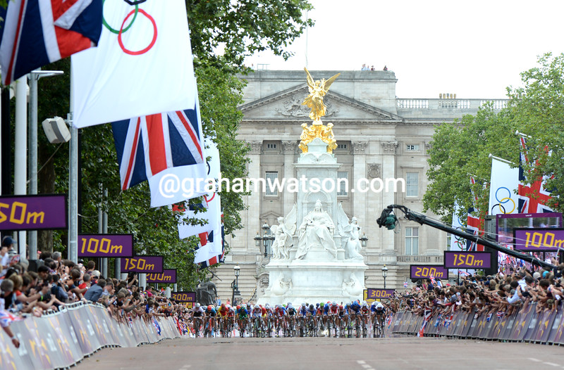 Mark Cavendish leads the peloton on to The Mall about 40-seconds behind the winner