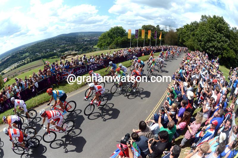 The peloton follows Team GB over Box Hill