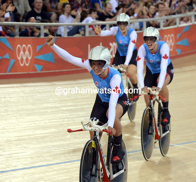 Canada celebrates its bronze medal performance in the womens team pursuit