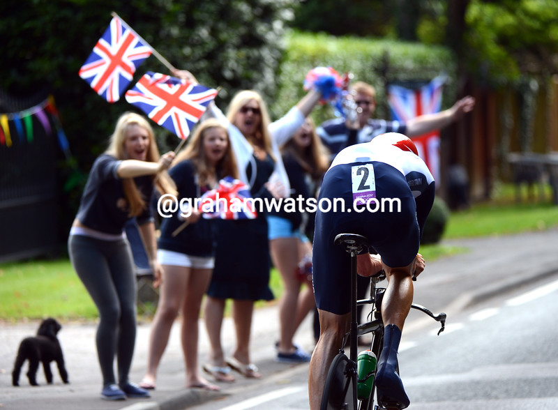 Go Wiggo! British fans (and their dog)  cheer Wiggins along the roads around Esher