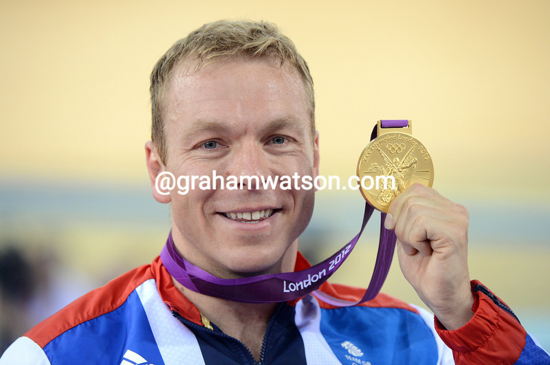 Chris Hoy displays his last-ever Olympic Gold medal after the Keirin event