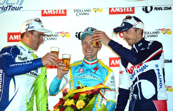 Cheers! Peter Sagan and Jelle Vanendert salute winner Enrico Gasparotto in Valkenburg...
