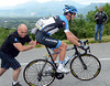 The pace is that slow that David Millar has the chance to tease his mechanic, Geoff Brown, after a wheel-change...