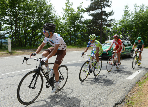 Biel Kadri has found amusement at the roadside as the escape climbs the Col du Lalouvesc with a three-minute lead...