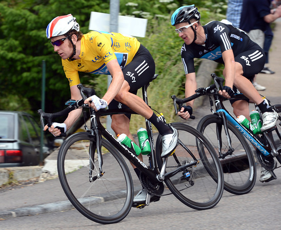 Wiggins leads Michael Rogers through a downhill bend, his mind very much on tomorrow's long TT...