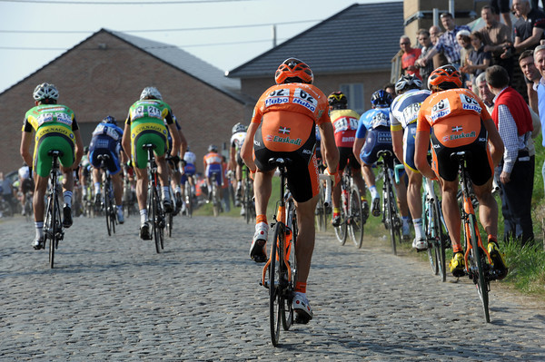 Euskatel riders struggle on an uphill section of cobbles somewhere between the Eikenberg and the Taaienberg...