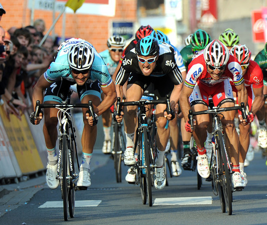 Tom Boonen leads a tight sprint between himself, Oscar Freire and Bernhard Eisel...