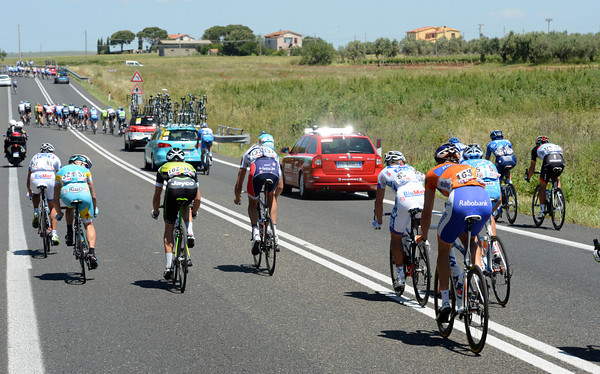 Strong winds have split the peloton just five-kilometres into the race - but team cars have got between the gaps and will neutralise the situation before race-officials realise what's going on..!