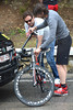 Max Sciandri and the BMC mechanic have to swap Phinney's seat-post before he can ride again...