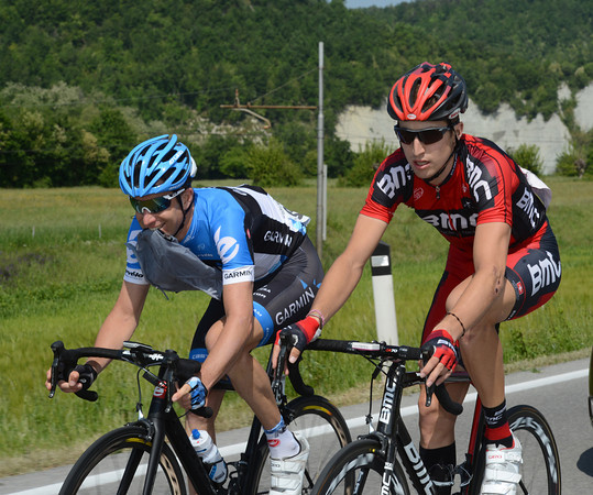 Christian Vande Velde is trying hard to make a younger American, Taylor Phinney, laugh after a few hard days in the saddle...