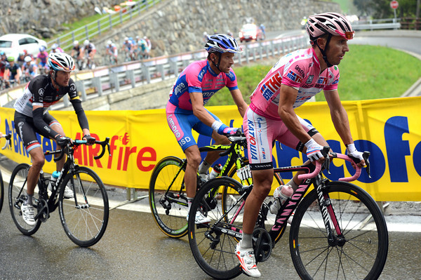 Joachim Roriguez is marked by Michele Scarponi and Franck Schleck...