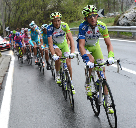 Liquigas is still setting the pace behind, led by Sylvester Szmyd and Ivan Basso...