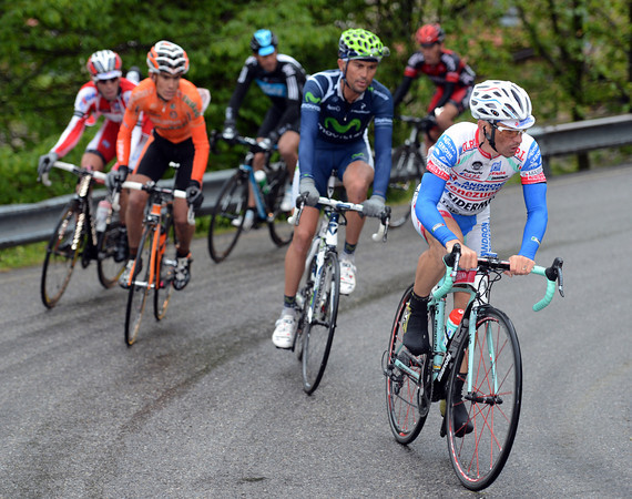 Emmanuele Sella leads a six-man counter-attack on the Valcava climb - they are about six minutes behind Rabottini, who is now alone...