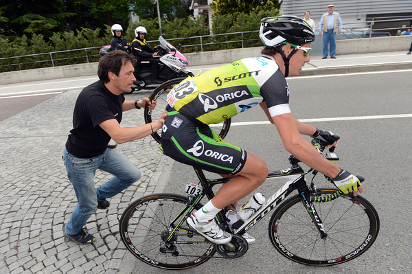 Daryl Impey's day has turned bad - he makes a wheel change in the first kilometres...
