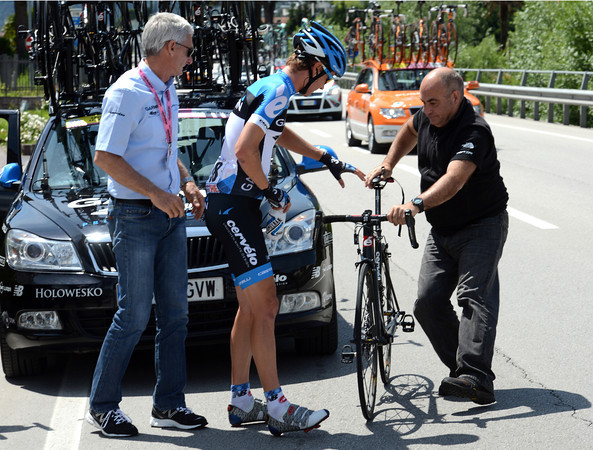 Peter Stetina has the attention of team manager Allan Peiper and mechanic Geoff Brown as he changes his bike...