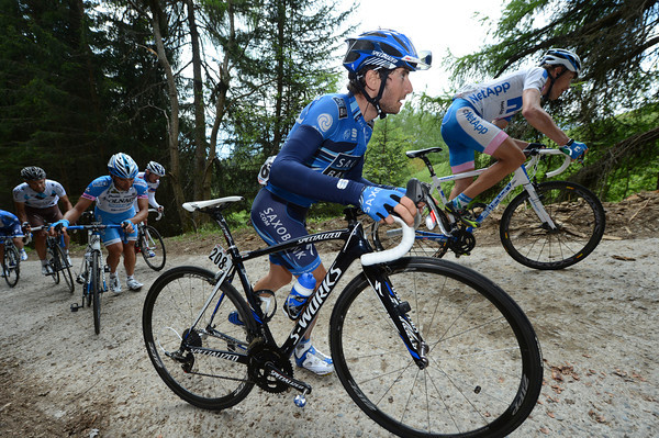 Manuele Boaro is forced to walk, while others ride or run nearby...