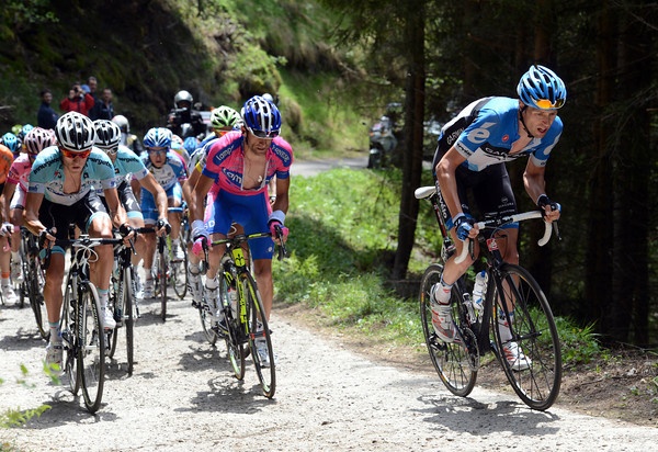 Hesjedal's group has come together on the bumpy 'road' to the top of the Mortirolo - peace resumes for a while...