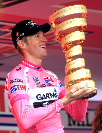 Hesjedal looks delighted with his name on the trophy - now this is what it's all about..!