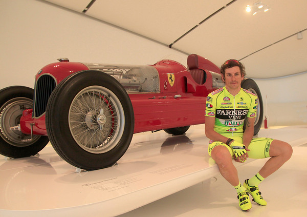 Filippo Pozzato poses with a classic Ferrari (that's actually a 1935 Alfa Romeo) before the start in Modena...