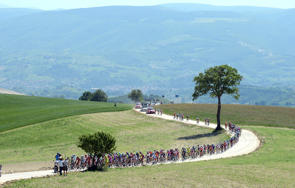 The peloton is about eight minutes down on the unsurfaced climb...
