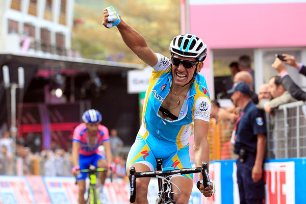Paolo Tiralongo wins stage seven after joining Michele Scarponi in a last-kilometre attack...