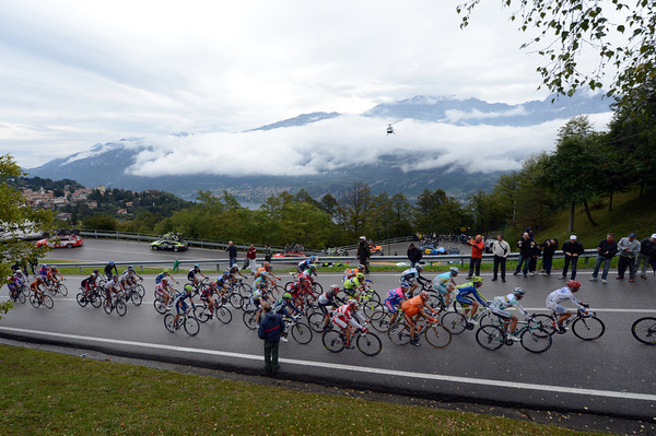 About 35 riders form the main group as it climbs the cloud-covered Madonna del Ghisallo in gentle pursuit of De Weert...