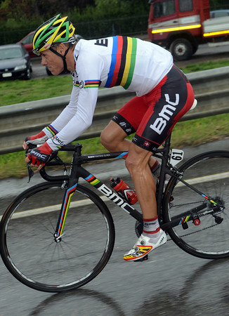 All eyes are on Philippe Gilbert in his first race as World Champion - but he's getting his new jersey very wet now..!