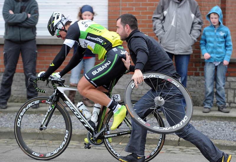 Aidis Kuopis at least waited until the race began before changing a flat tyre...