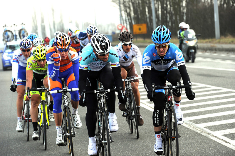 Tom Boonen and Tyer Farrar discuss tactics at the head of the escape - but they've yet to catch Van Avermaet...