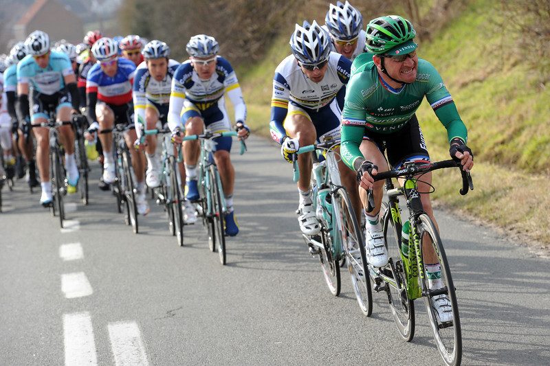 Thomas Voeckler leads the peloton in pursuit with 50-kilometres to go...