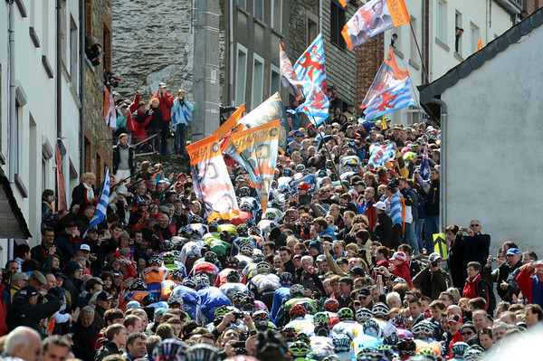 The peloton climbs the Cote de Saint-Roche between hundreds of Schleck fans - and seven minutes behind too...