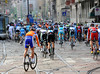 Not for the faint-hearted - the cyclists weave their way towards the official start, over tramlines and cobblestones...