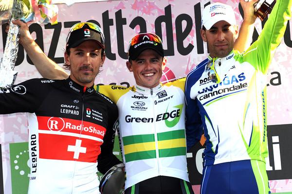 Simon Gerrans celebrates his extraordinary win alongside Cancellara and Nibali...