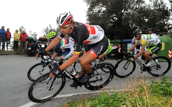 Fabian Cancellara descends a bit later - at the head of the disintegrading peloton...