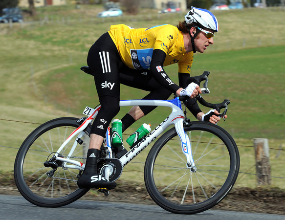 Bradley Wiggins swoops down the same descent four minutes later - he's switched back to his normal road bike after experimenting with a climbing bike from the start...