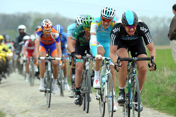 Stannard is chasing hard too - the uphill section of cobbles is creating the final selections...